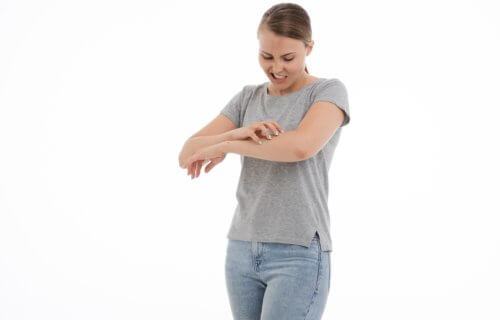 Woman scratching an itch on her arm