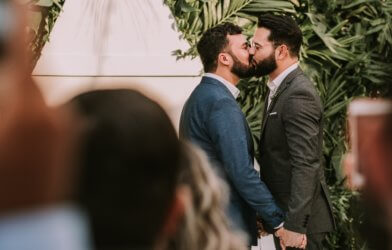 Gay couple kissing at wedding