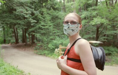 Woman wearing face mask during nature walk