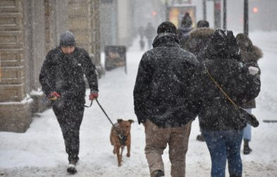 People walking in the snow in the city