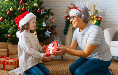 Grandma giving granddaughter Christmas or holiday gift