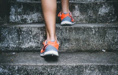 Person walking up stairs, steps for exercise