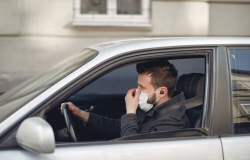Man driving with face mask