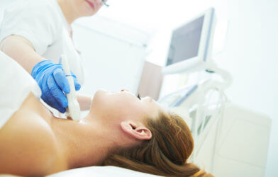Woman undergoing thyroid cancer screening