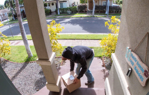Porch pirate: Thief stealing package