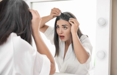 Woman finds gray hair looking in mirror