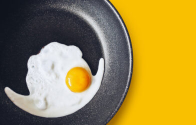 Egg being cooked on non-stick frying pan