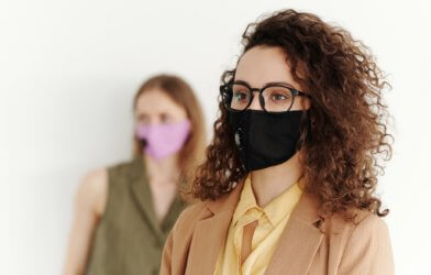 Woman in glasses wearing face mask during COVID-19 pandemic