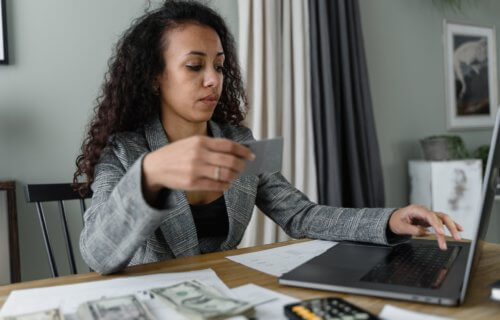 woman paying bills money