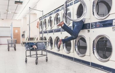 Person doing laundry at laundromat