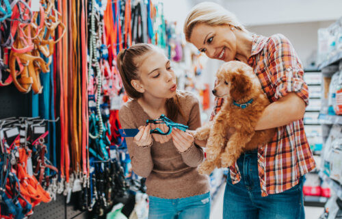 Mother, daughter with dog at pet store