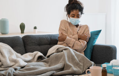 Woman feeling sick with COVID or flu symptoms