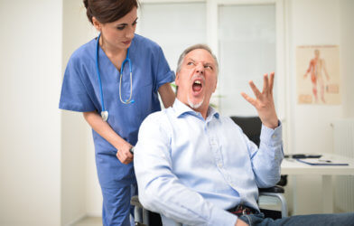 Angry patient at doctor's office yelling at nurse