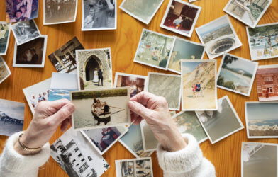 Person looking at old photos and memories