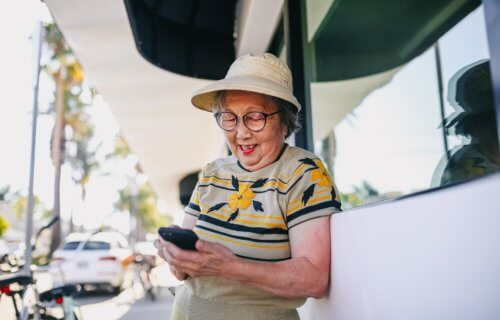 old woman texting smartphone
