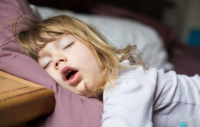 Child sleeping in bed