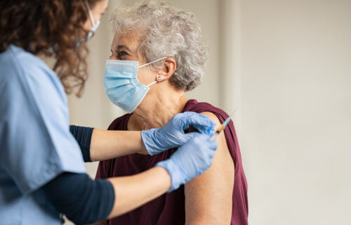 Older woman receiving COVID-19 vaccine