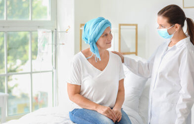 Doctor talking to cancer patient