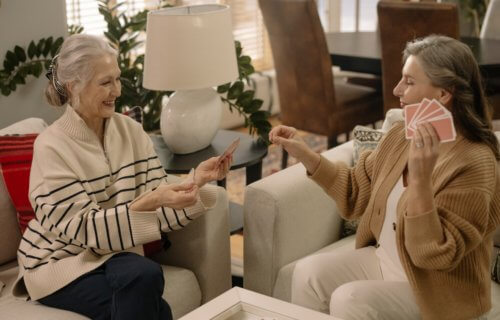 older adults playing cards
