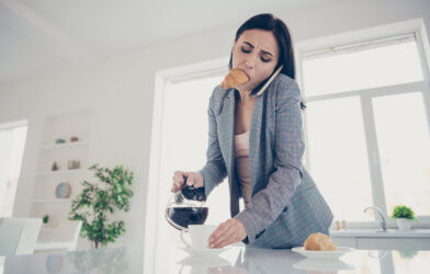 Woman in a hurry getting ready for work in the morning