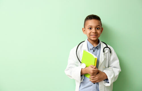 Young boy dressed as a doctor