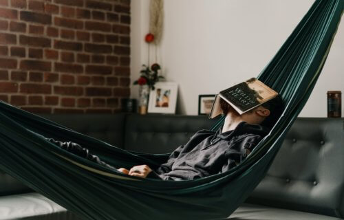 Man taking a nap in a hammock during his free time
