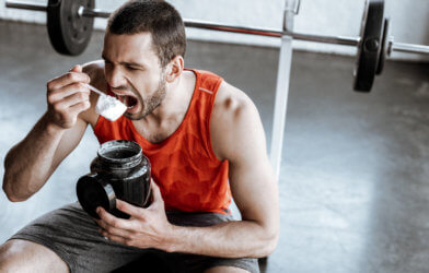 Man eating protein powder; dry scooping challenge